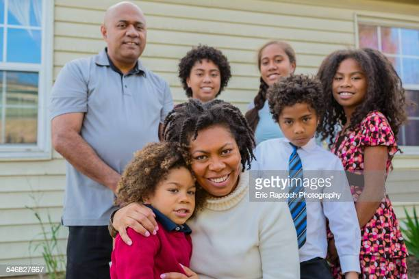 pacific islander family smiling outdoors - middle class stock pictures, royalty-free photos & images