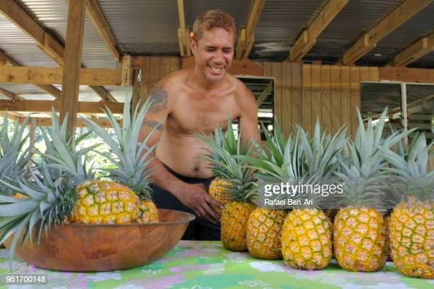 pacific islander farmer gearing up for seasonal pineapple sale - rafael ben ari stock pictures, royalty-free photos & images