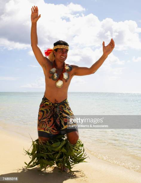 Pacific Islander man in traditional dress on beach