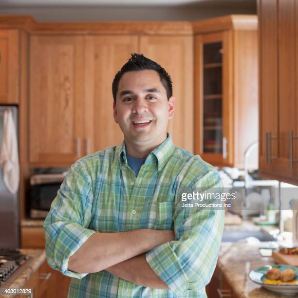 Pacific Islander man smiling in kitchen