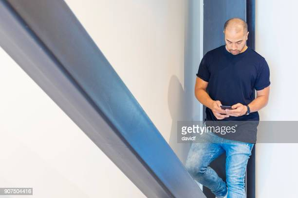 Pacific Islander Man Using a Mobile Telephone