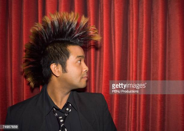 Pacific Islander man with mohawk