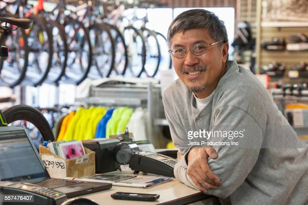 Pacific Islander man working in bicycle shop