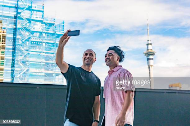 Pacific Islander Men Taking Selfies With Auckland Skytower
