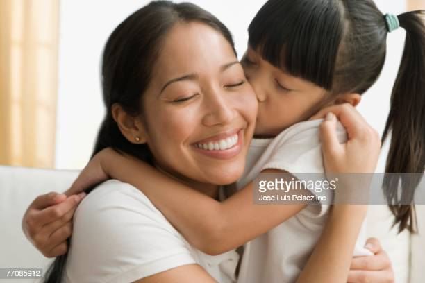pacific islander mother and daughter hugging - filipino ethnicity and female not male stock pictures, royalty-free photos & images