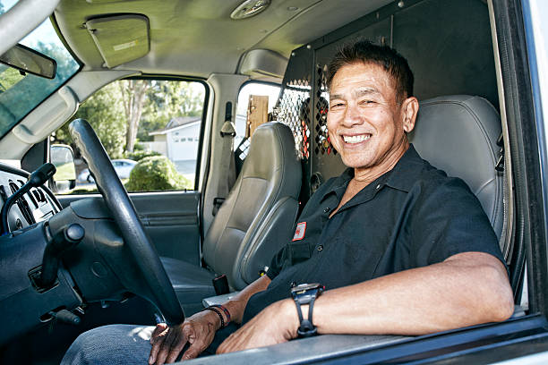 pacific islander plumber smiling in van - asian old man driving stock pictures, royalty-free photos & images
