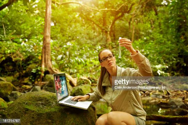 pacific islander researcher testing samples in jungle - botanist stock pictures, royalty-free photos & images