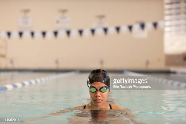 Pacific Islander swimmer in swimming pool