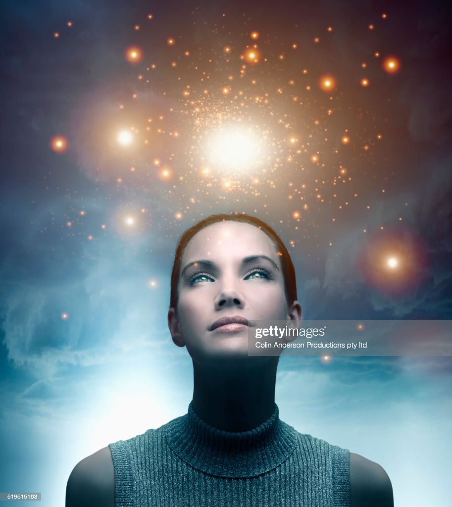 Pacific Islander woman admiring glowing lights in sky : Stock Photo