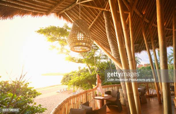 Pacific Islander woman admiring view from patio