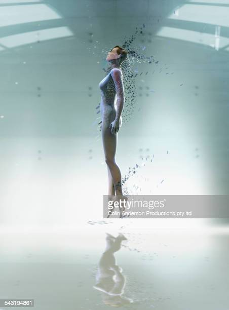 pacific islander woman floating in futuristic body scan - hovering stock pictures, royalty-free photos & images