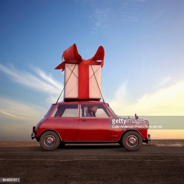 pacific islander woman hauling gift on car - funny christmas stock photos and pictures