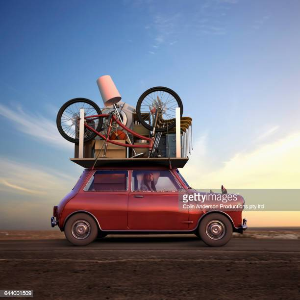 pacific islander woman hauling possessions on car - belongings stock photos and pictures