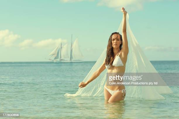 pacific islander woman holding scarf in ocean - hot women on boats stock pictures, royalty-free photos & images