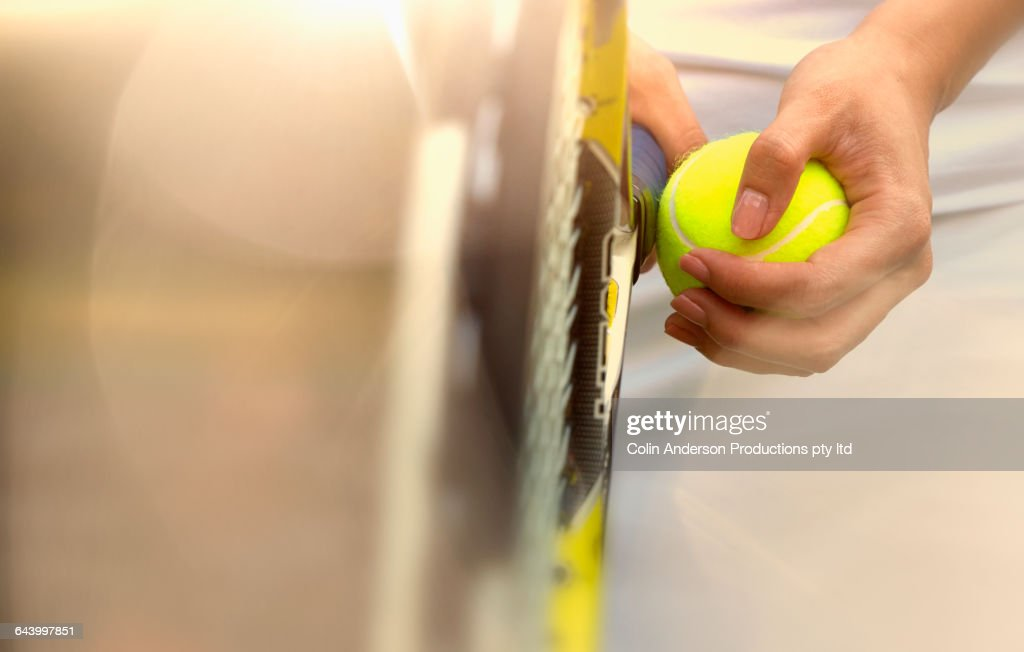 Pacific Islander woman holding tennis ball : Foto stock