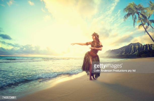pacific islander woman hula dancing on beach - hula dancer stock pictures, royalty-free photos & images