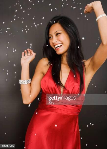 Pacific Islander woman in evening gown dancing