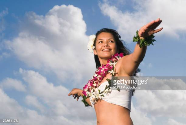Pacific Islander woman in lei dancing