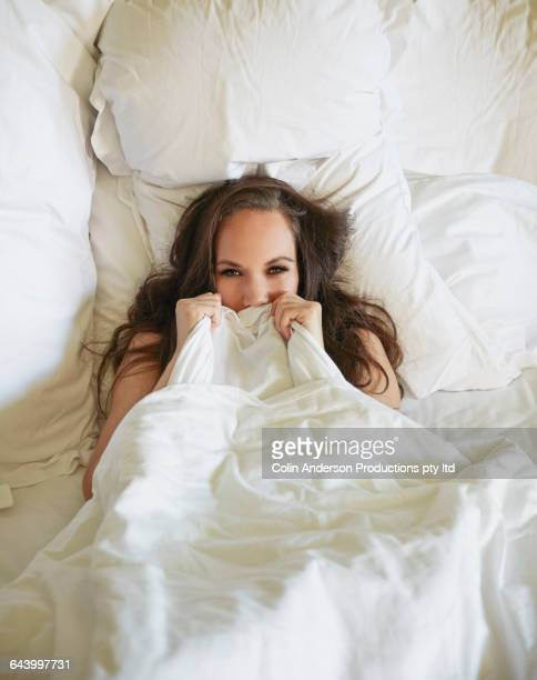 Pacific Islander woman laying in bed