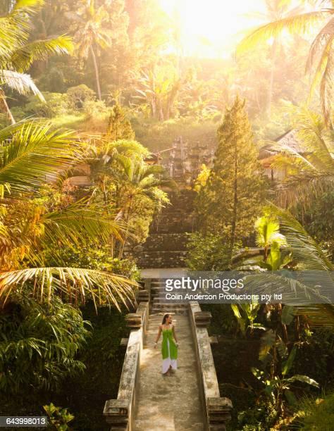 Pacific Islander woman on walkway in jungle