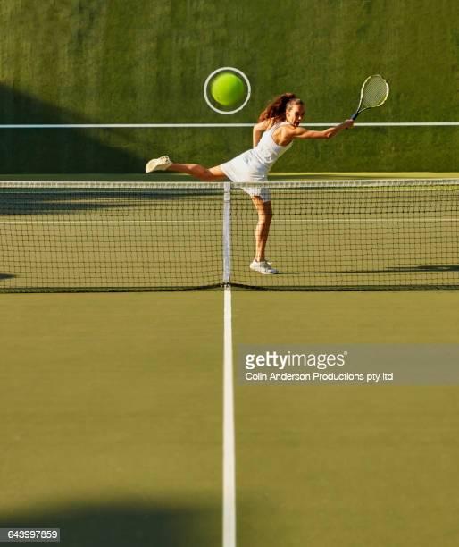Pacific Islander woman playing tennis