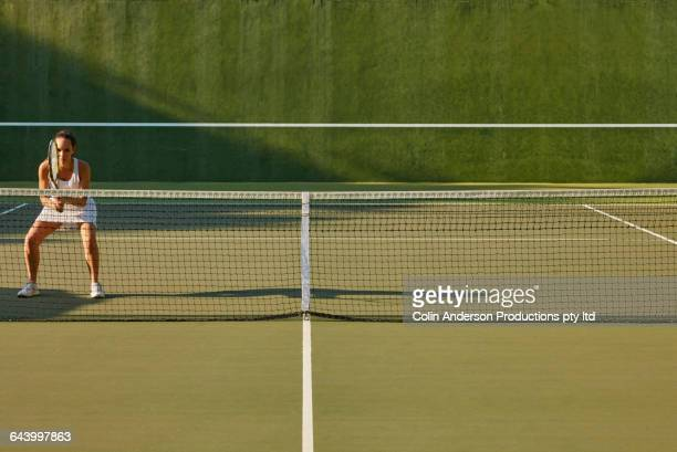 pacific islander woman playing tennis - tennis stock pictures, royalty-free photos & images