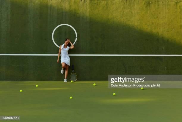 Pacific Islander woman standing on tennis court