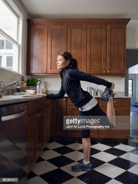 pacific islander woman stretching - filipino ethnicity and female not male stock pictures, royalty-free photos & images