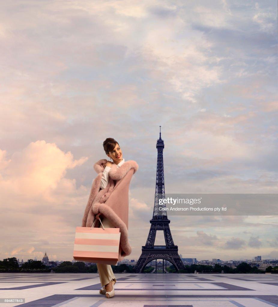 Pacific Islander woman walking near Eiffel Tower, Paris, Ile : Stock Photo