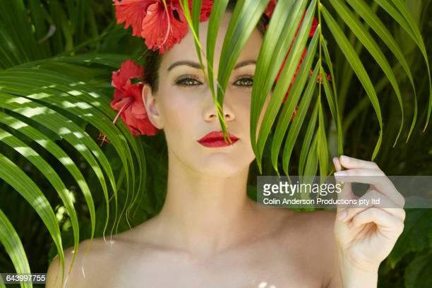 Pacific Islander woman wearing flowers and glamorous makeup