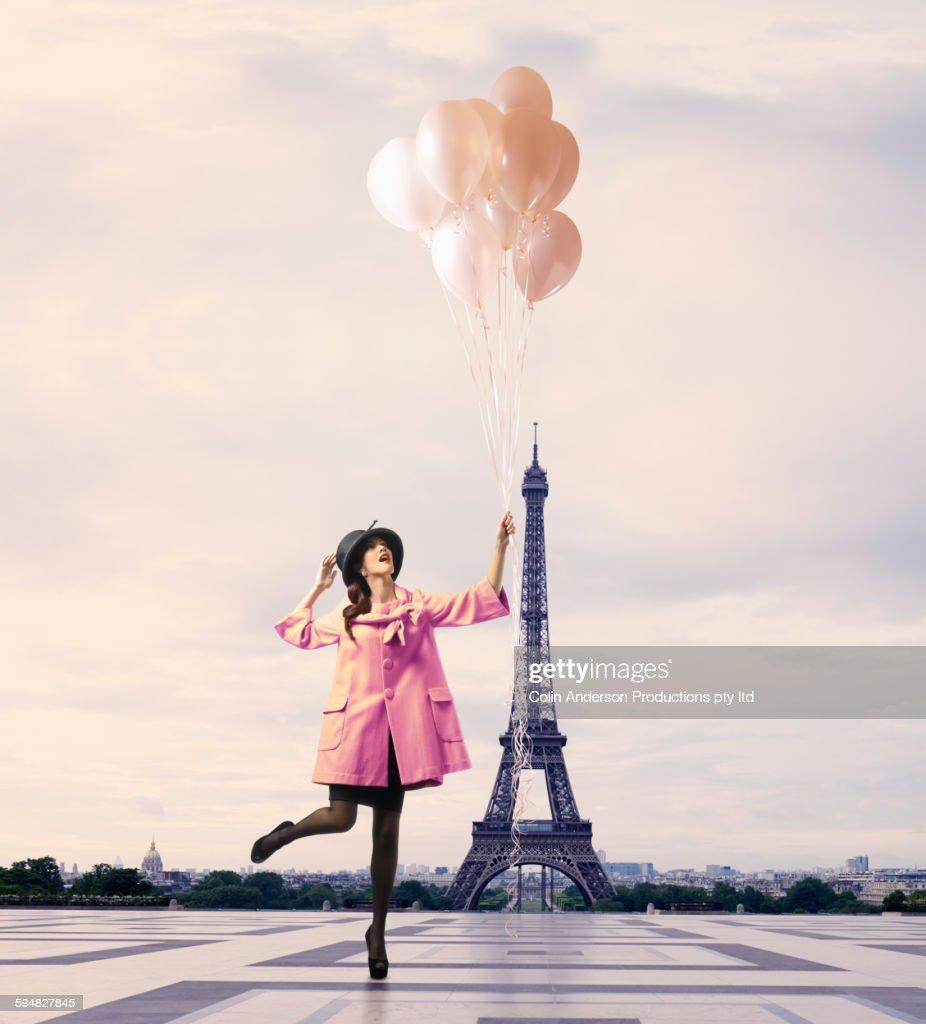 Pacific Islander woman with balloons near Eiffel Tower, Paris, Ile : Stock Photo