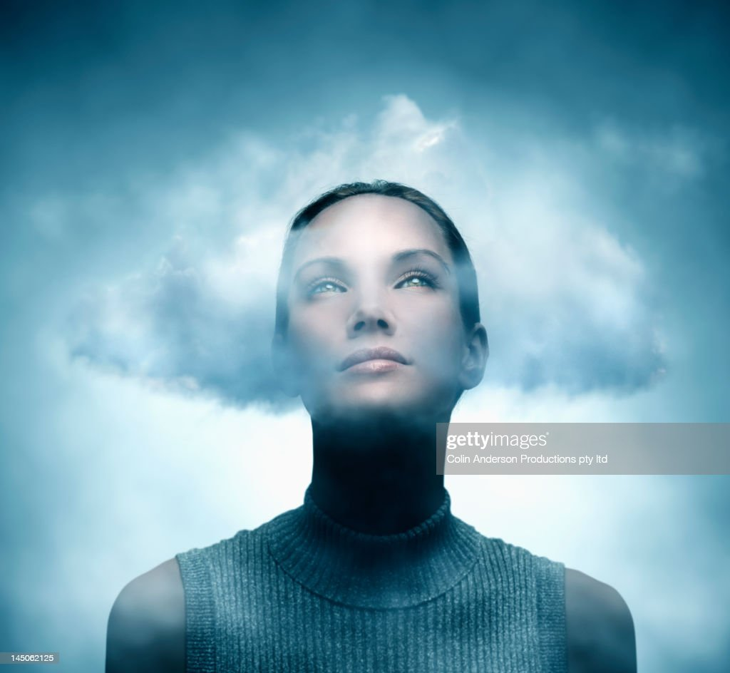 Pacific Islander woman with her head in the clouds : Stock Photo