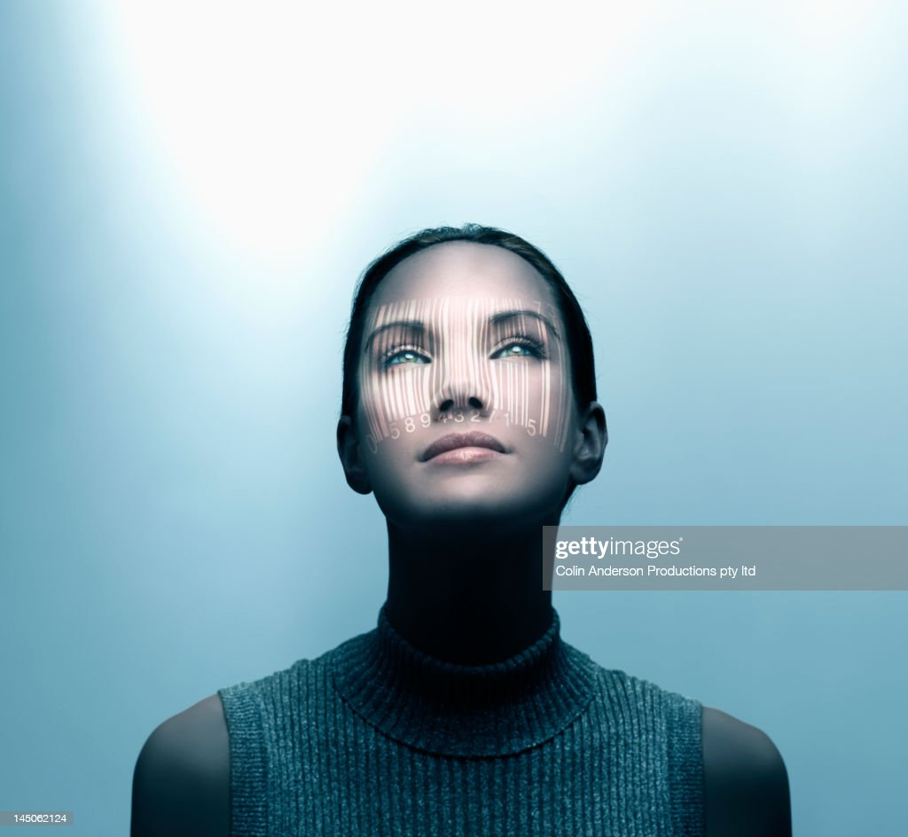 Pacific Islander woman with shadow of bar code on her face : Stock Photo