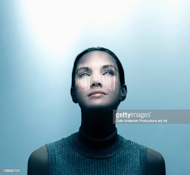 pacific islander woman with shadow of bar code on her face - data privacy stock pictures, royalty-free photos & images