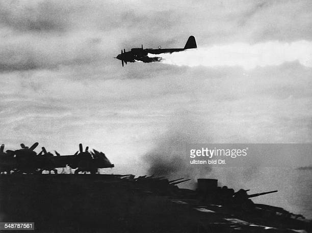 Pacific, Japan: Battle of Okinawa Japanese air raids on the US fleet at Okinawa: shooting down a burning Japanese fighter aircraft; in front a US...