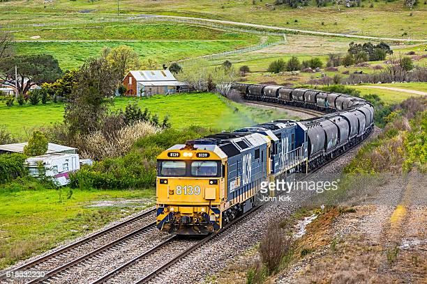 Pacific National bulk grain train rounding bend in rural landscape