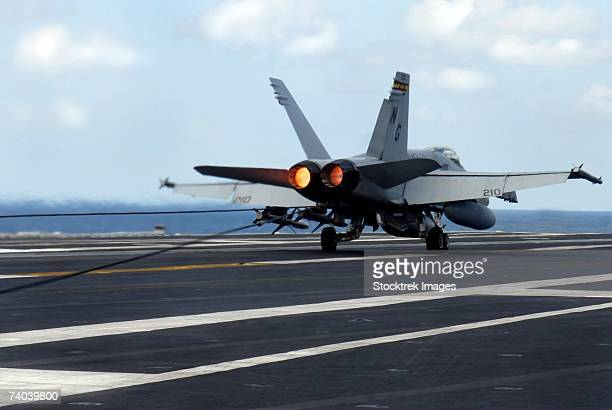 Pacific Ocean (January 21, 2007)- An F/A-18C Hornet assigned to the Death Rattlers of Marine Strike Fighter Squadron Three Two Three (VMFA-323) successfully lands on the flight deck of the Nimitz-class aircraft carrier USS John C. Stennis (CVN 74).