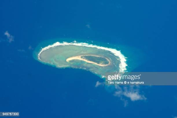 Pacific Ocean and Gaferut Island in the state of Yap, Federated States of Micronesia, daytime aerial view from airplane
