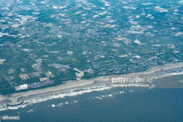 Pacific Ocean and Kamisu city in Ibaraki prefecture in Japan daytime aerial view from airplane