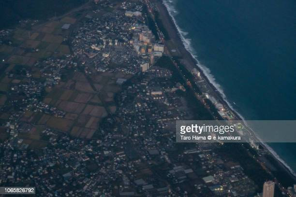 Pacific Ocean and Kamogawa city in Chiba prefecture in Japan daytime aerial view from airplane
