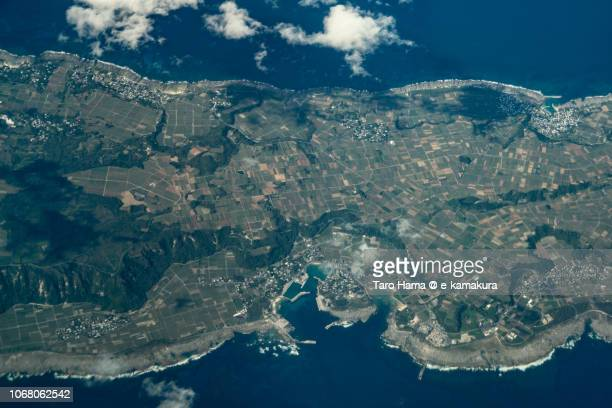 Pacific Ocean and Kikaijima in Kagoshima prefecture in Japan daytime aerial view from airplane