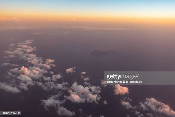 Pacific Ocean and Kozu-shima Island in Tokyo sunset time aerial view from airplane