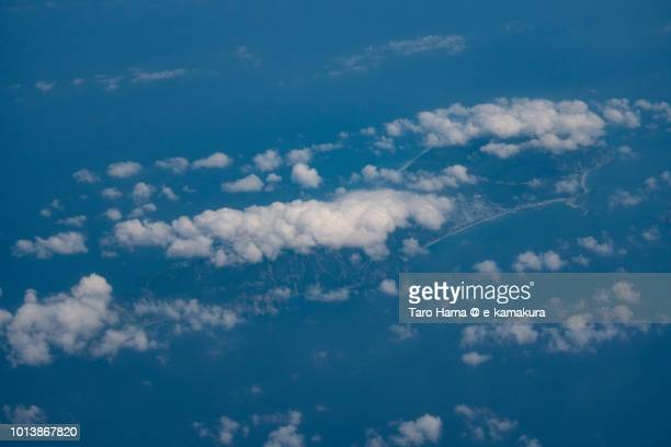 Pacific Ocean and Niijima Island in Tokyo in Japan daytime aerial view from airplane