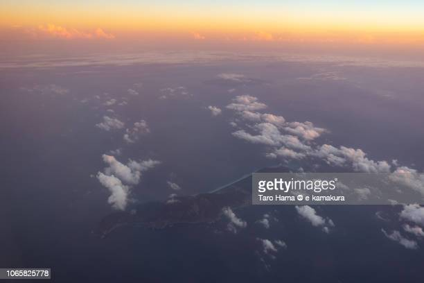 Pacific Ocean and Nii-jima Island in Tokyo sunset time aerial view from airplane