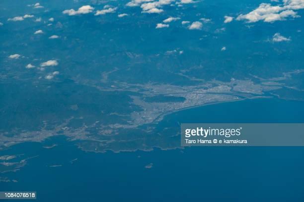 Pacific Ocean and Nobeoka city in Miyazaki prefecture in Japan daytime aerial view from airplane