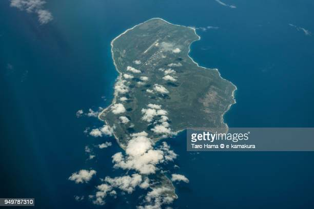 pacific ocean and rota island in northern mariana islands, daytime aerial view from airplane - 北マリアナ諸島 ストックフォトと画像