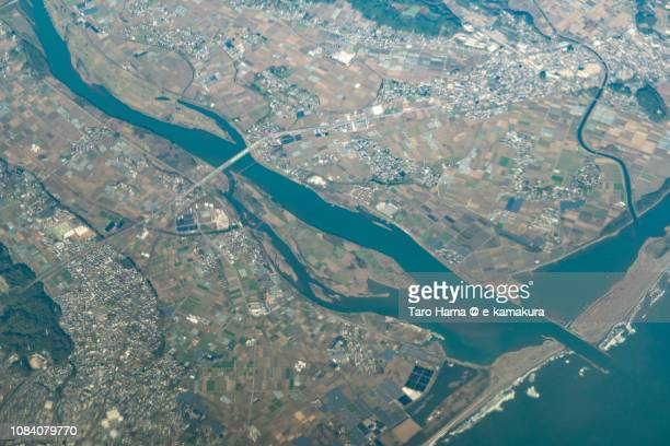 Pacific Ocean and Shintomi town in Miyazaki prefecture in Japan daytime aerial view from airplane