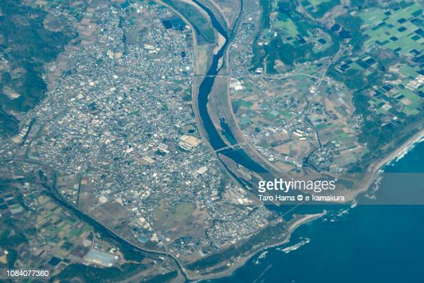 Pacific Ocean and Takanabe town in Miyazaki prefecture in Japan daytime aerial view from airplane