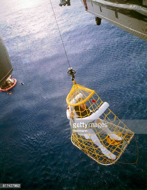 Apollo 13 commander James A Lovell Jr is lifted aboard a helicopter after splashdown