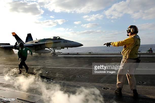 Pacific Ocean (November 13, 2006) - Chief Aviation Boatswain's Mate ensures an F/A-18C Hornet is cleared for launch from the flight deck aboard USS Kitty Hawk (CV 63).